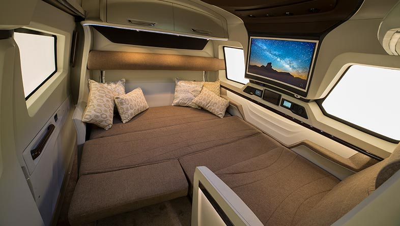 The sleeping area in the Luxury RV can be extended by folding down the sofas into a massive sleeping platform