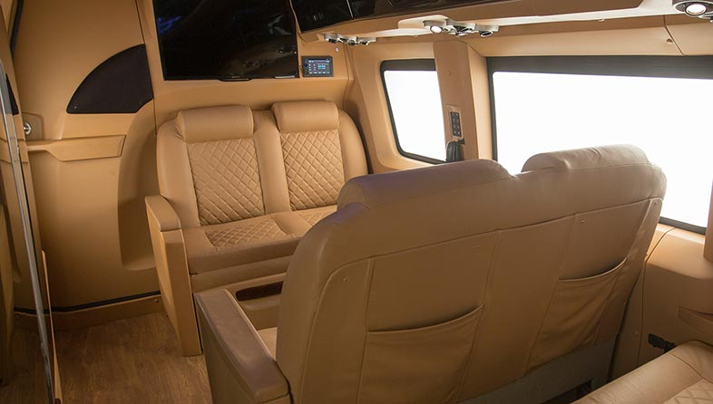 Leather seats throughout, with a noise cancelling interior masked with beige walls.