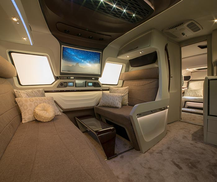 The inside of the Finetza Luxury Rv, looking a little bit like the inside of the millennium falcon. Very space age with big lights and HD screens
